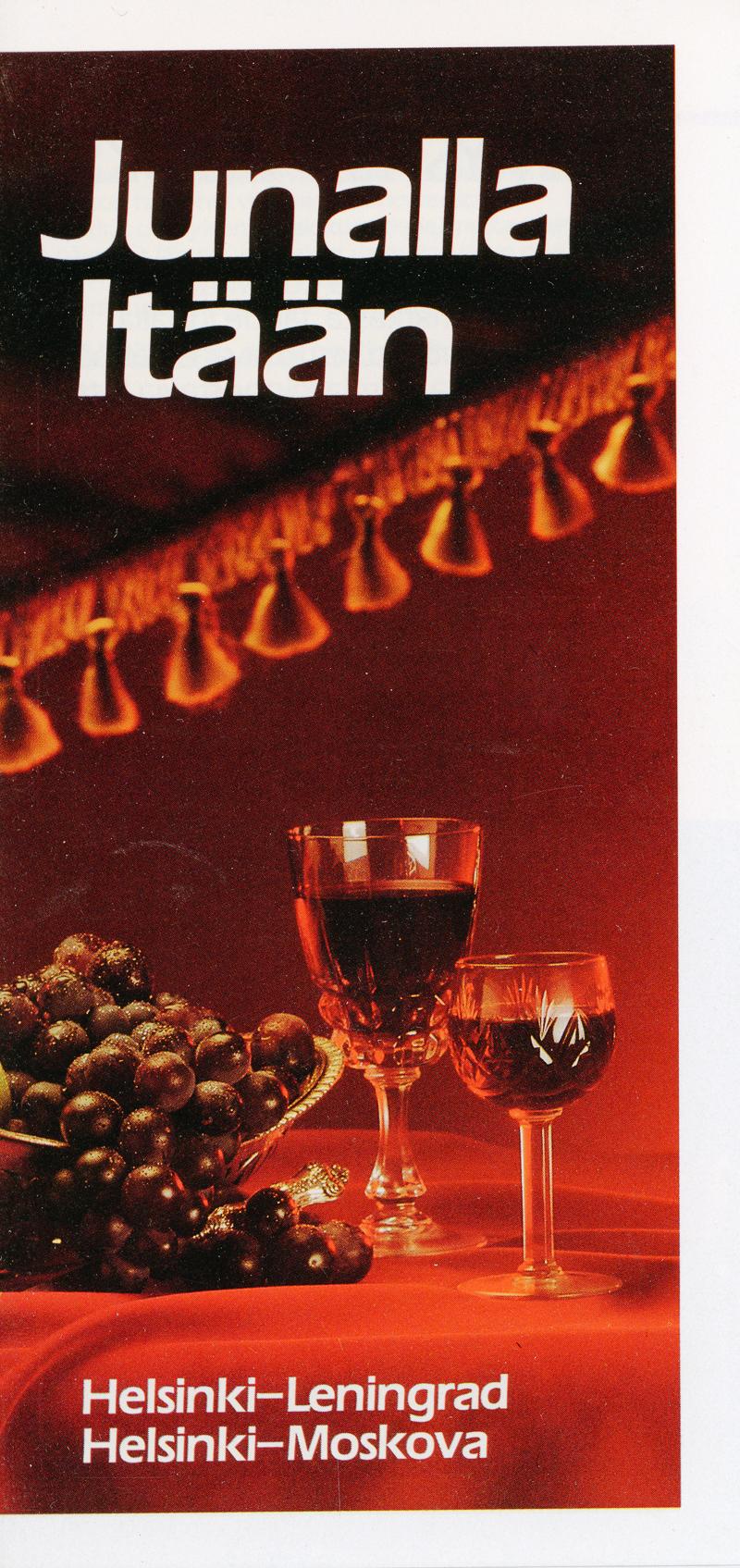 Junalla Itään -esitteen kansi, jossa viinirypäleitä ja viinilasit.